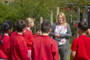Headteacher talking to children